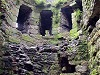 Beaumaris castle wales welsh uk inside view looking up worms eye view windows dark dank